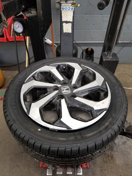 clamp positioning of the wheel assembly for tire removal