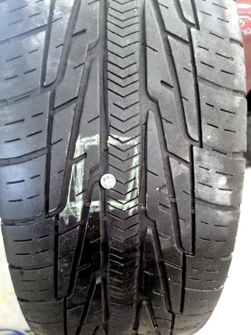 locating and marking the cause of the flat tire