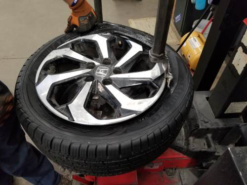 mounting the outer bead of the tire