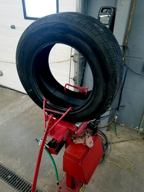 tire placed on tire spreader